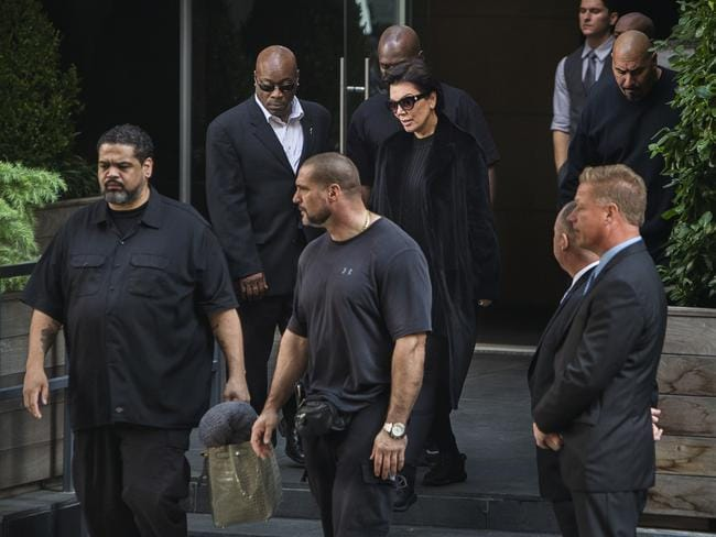 Kris Jenner is surrounded by security as she leaves the New York residence where her daughter Kim Kardashian West is staying. Picture: AP/Andres Kudacki