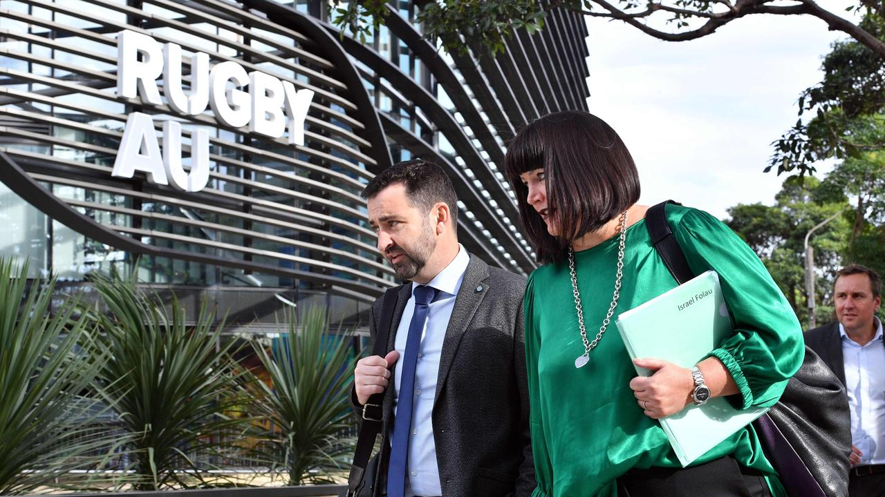 Rugby Australia CEO Raelene Castle (R) and NSW Rugby CEO Andrew Hore (L) walk towards the Rugby Australia head office in Sydney on May 4, 2019.