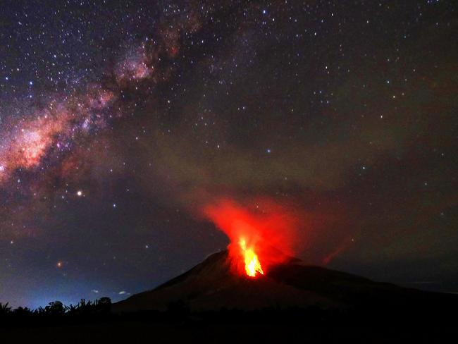 Hot lava flows down the Mount Sinabung volcano in the night on July 30, 2017. Sinabung roared back to life in 2010 for the first time in 400 years. Picture: Tibta Pangin