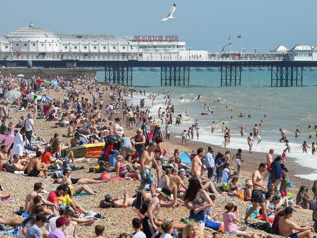 Brighton beach is packed. Picture: Simon Dack / Alamy Live News