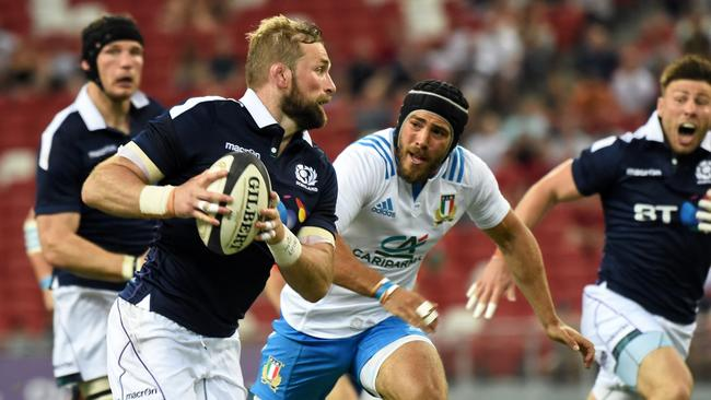 John Barclay of Scotland runs against Italy at the National Stadium in Singapore.