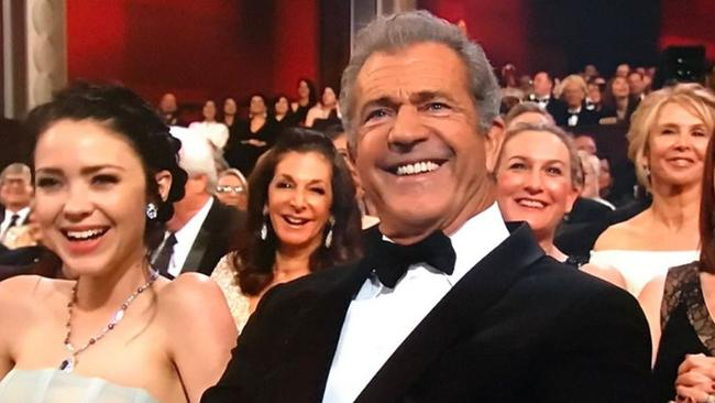 Mel Gibson reacts to Kimmel's shout out during the Oscars opening monologue.