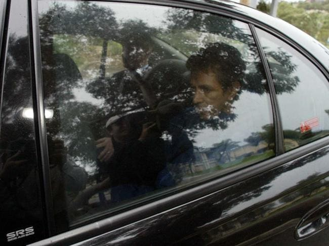 Gary Narkle, one of the nation's worst serial rapists, arrives in court in the back of a police car in Perth.