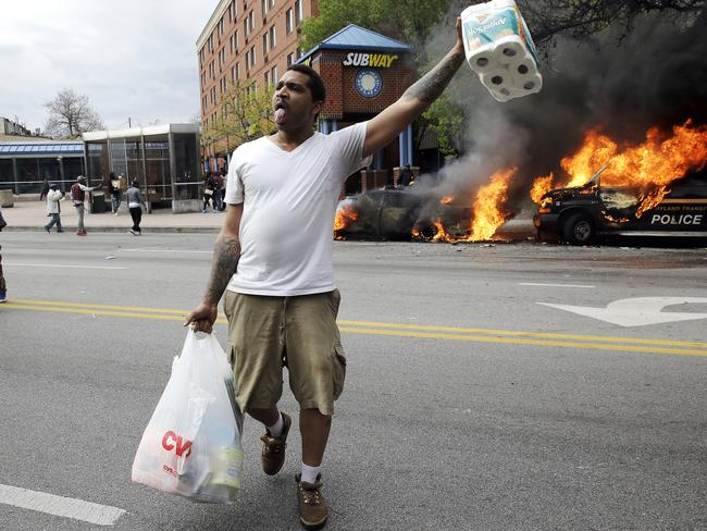 Violence erupts ... Protesters looted local shops and tensions flared. Picture: AP/Patrick Semansky