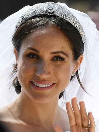 Meghan Markle in Queen Mary's diamond art deco tiara on her big day. Picture: Bruce Adams – WPA/Getty Images.