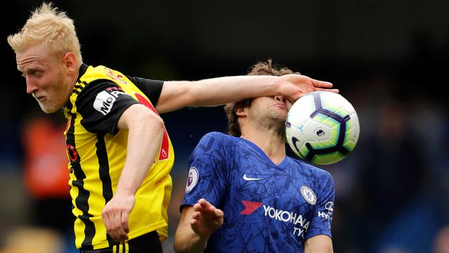 Watford's Will Hughes clashes with Chelsea's Marcos Alonso at Stamford Bridge in London. Picture: Richard Heathcote/Getty