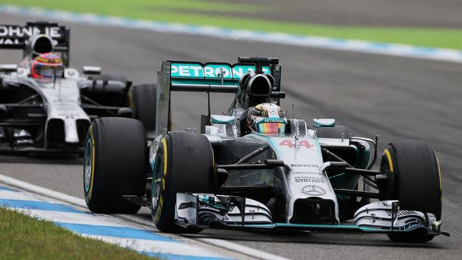A few corners after the contact. Note the damage to Hamilton's wing.