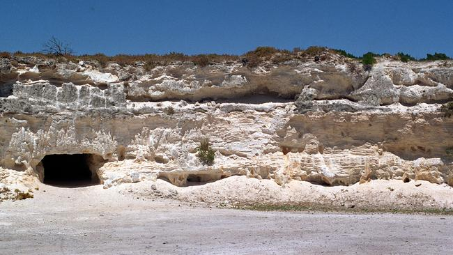 "Robben Island quarry where Nelson Mandela and other political prisoners had to work in blinding light and intense heat. The hole in the wall was used as a ""toilet"" and for clandestine meetings. Picture: Megan Palin."