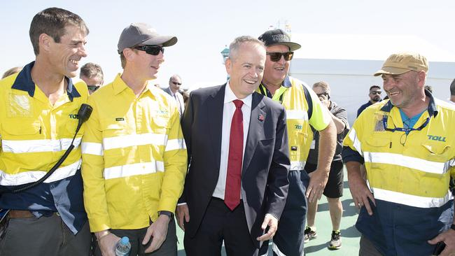 Bill Shorten posed for photos with Toll workers in Port Melbourne this month. Picture: AAP/Ellen Smith