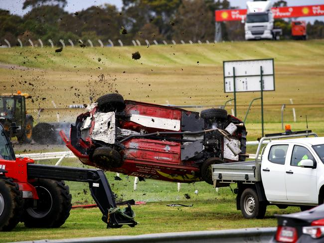 The vehicle rolled five times before landing on the back of a ute.