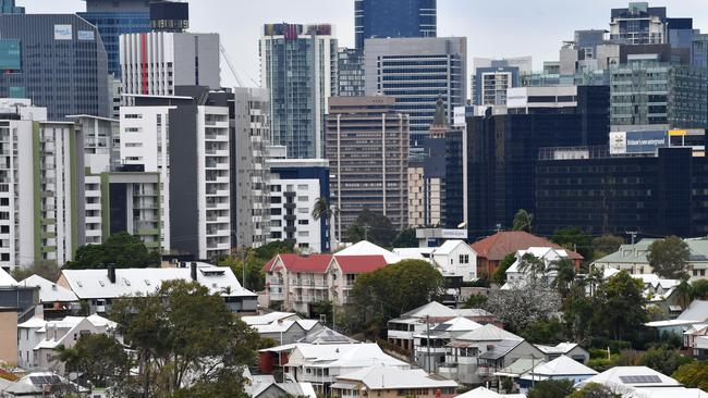 The suburbs of Paddington and Petrie Terrace are seen with the Brisbane CBD skyline in the background. Image: AAP/Darren England.