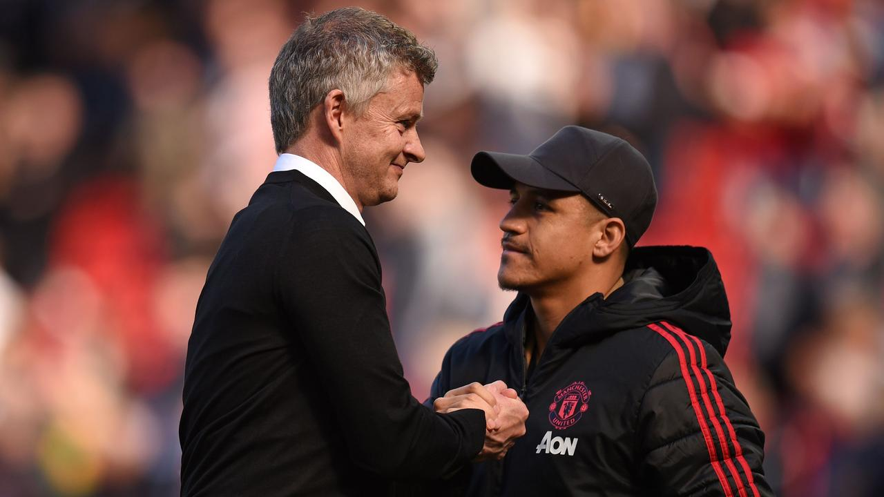 Ole Gunnar Solskjaer shakes hands with out-of-form Alexis Sanchez