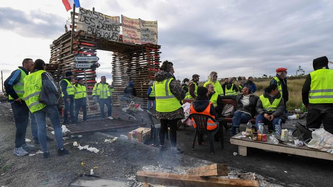 Yellow vests protesters block the road leading to the Frontignan oil depot in the south of France, as they demonstrate against the rise in fuel prices. Picture: AFP