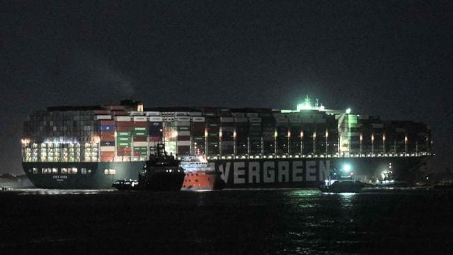 Tugboats around the MV Ever Given on Saturday. Picture: Ahmed Hasan/AFP