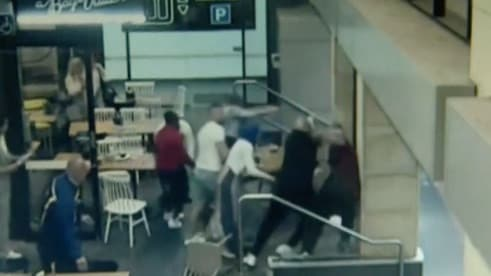 Horrifying vision captures the moment a heavily pregnant woman was attacked in a cafe.
