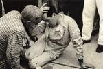 An exhausted Sir Jack Brabham pictured after pushing his car over the line to win the 1959 F1 Championship in Florida.