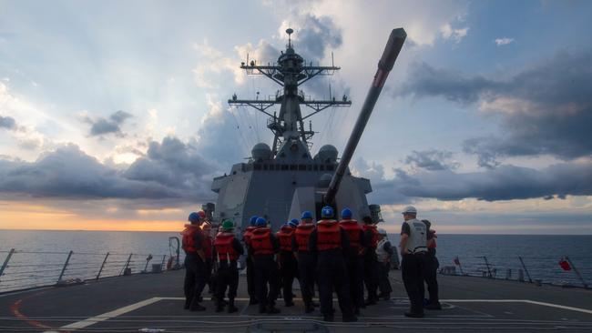 US sailors receive a safety brief on the Arleigh Burke-class guided-missile destroyer USS Dewey during exercises in the South China Sea. Picture: AFP.