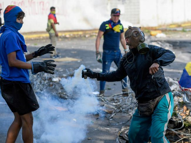 nti-government protesters clash with security forces in Caracas during the commemoration of May Day. Picture: AFP
