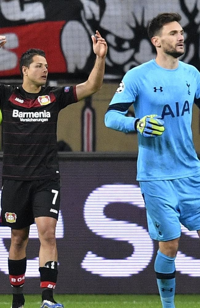 Leverkusen's Javier Hernandez, left, reacts after he missed.