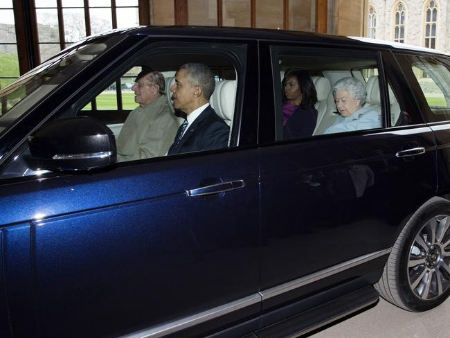 Prince Philip drives the Queen and the Obamas at Windsor in 2016. Picture: WPA/Getty Images