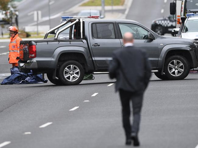 An SUV was dumped on The Mountain Highway in Bayswater after a short police chase. Picture: Julian Smith/AAP