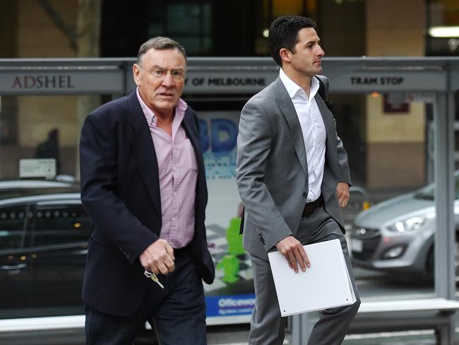 Larry Perkins and Jamie Whincup arrive for the appeal hearing. Pic: Jake Nowakowski