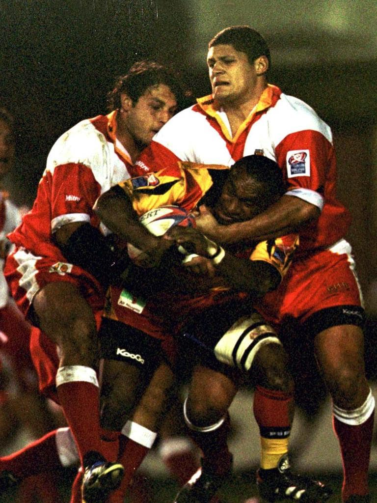 Stanley Gene of Papua New Guinea is tacked by Willie Mason of Tonga at the 2000 World Cup