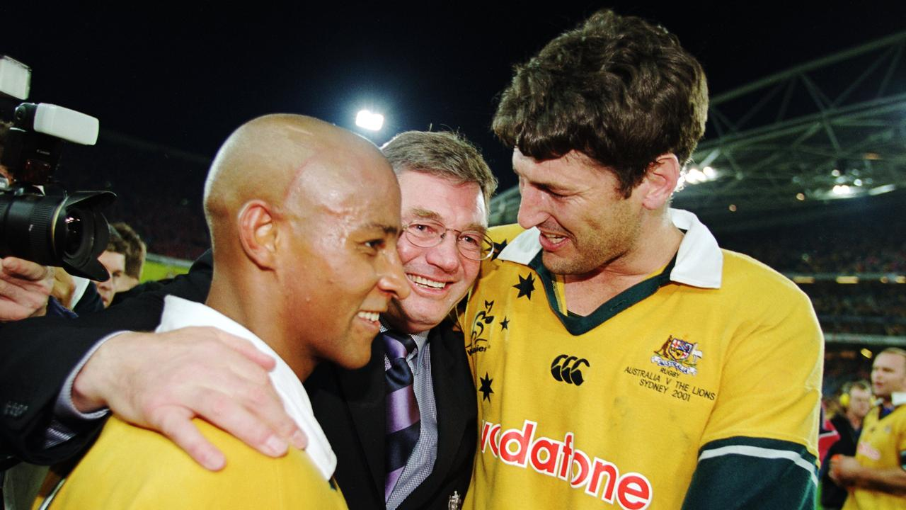 George Gregan and John Eales of Australia are congratulated by coach Rod Macqueen.