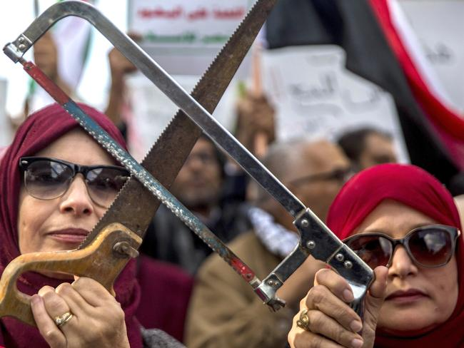 Tunisians demonstrate with saws on Tuesday as the Crown Prince visited his Middle Eastern allies en route to the G20. Picture: Hassene Dridi