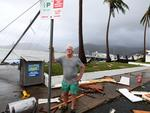 Local council worker Brian Doyle inspects damage at Shute Harbour, Airlie Beach, Wednesday, March 29, 2017. Picture: AAP Image/Dan Peled
