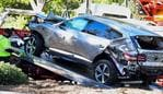 "A tow truck recovers the vehicle driven by golfer Tiger Woods in Rancho Palos Verdes, California, on February 23, 2021, after a rollover accident. - Woods was hospitalized Tuesday after a car crash in which his vehicle sustained ""major damage,"" the Los Angeles County Sheriff's department said. Woods, the sole occupant, was removed from the wreckage by firefighters and paramedics, and suffered ""multiple leg injuries,"" his agent said in a statement to US media. (Photo by Frederic J. BROWN / AFP)"