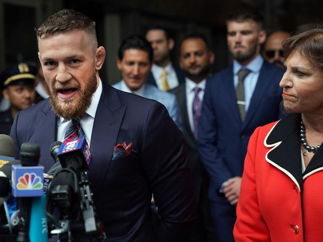 Irish mixed martial arts superstar Conor McGregor talks to the press after he pleaded guilty to a single violation of disorderly conduct, in Brooklyn Criminal Court. Picture: AFP