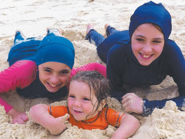 The three Sharrouf children remaining alive, Hoda (left), Humzeh and Zaynab (pictured on an Australian beach in 2012), are at imminent risk of bombing in Syria.