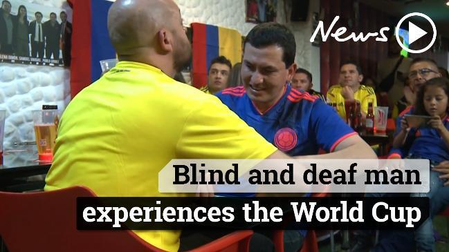 Blind and deaf man experiences the World Cup