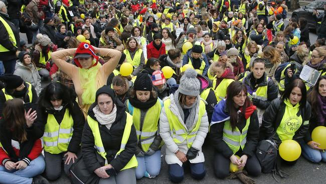 Women wearing yellow vests observes a minute of silence for the victims of the national yellow vest movement in Paris. Picture: AP