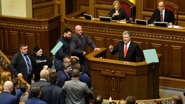Ukrainian President Petro Poroshenko (C) during an emergency session in Kiev ahead of a parliamentary vote to impose martial law in the country. Picture: AFP