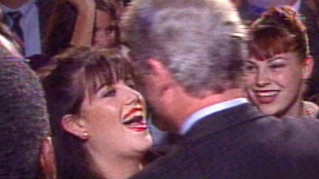 CNN TV video still from 1996 of former White House intern Monica Lewinsky greeting former US president Bill Clinton.