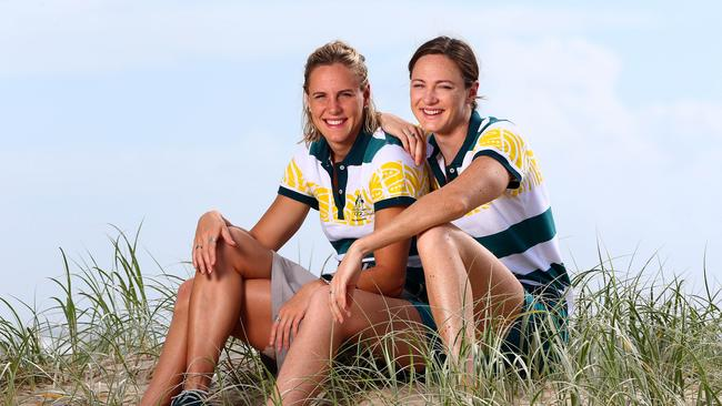 Bronte and Cate Campbell catch their breath together after competition finishes on the Gold Coast. Picture: Adam Head