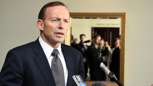 Under scrutiny ... gender equality advocates will be looking to Tony Abbott as Minister for Women to maintain a strong gender reporting scheme. Picture: News Corp Australia