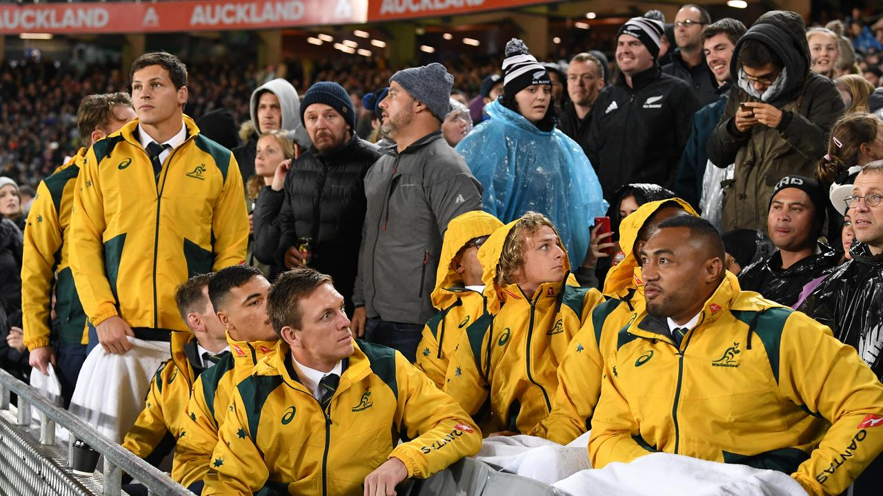 Wallabies players look on from the stands after a projectile was thrown near them by a spectator during the Bledisloe Cup match between the New Zealand All Blacks and the Australian Wallabies  at Eden Park in Auckland, New Zealand, Saturday, August 17, 2019. (AAP Image/Dave Hunt) NO ARCHIVING, EDITORIAL USE ONLY