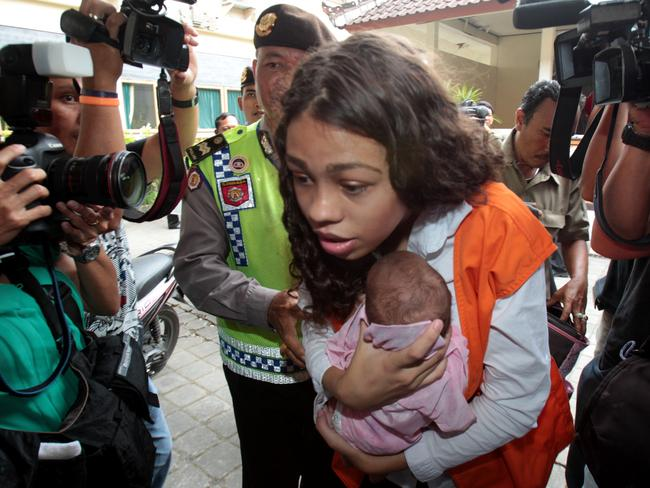 Set for a lengthy jail term ... Heather Mack holds her baby as arrives at Denpasar District Court before her boyfriend Tommy Schaefer is found guilty of murdering her mother and hiding her body in a suitcase during their holiday in Bali. Picture: Lukman S. Bintoro