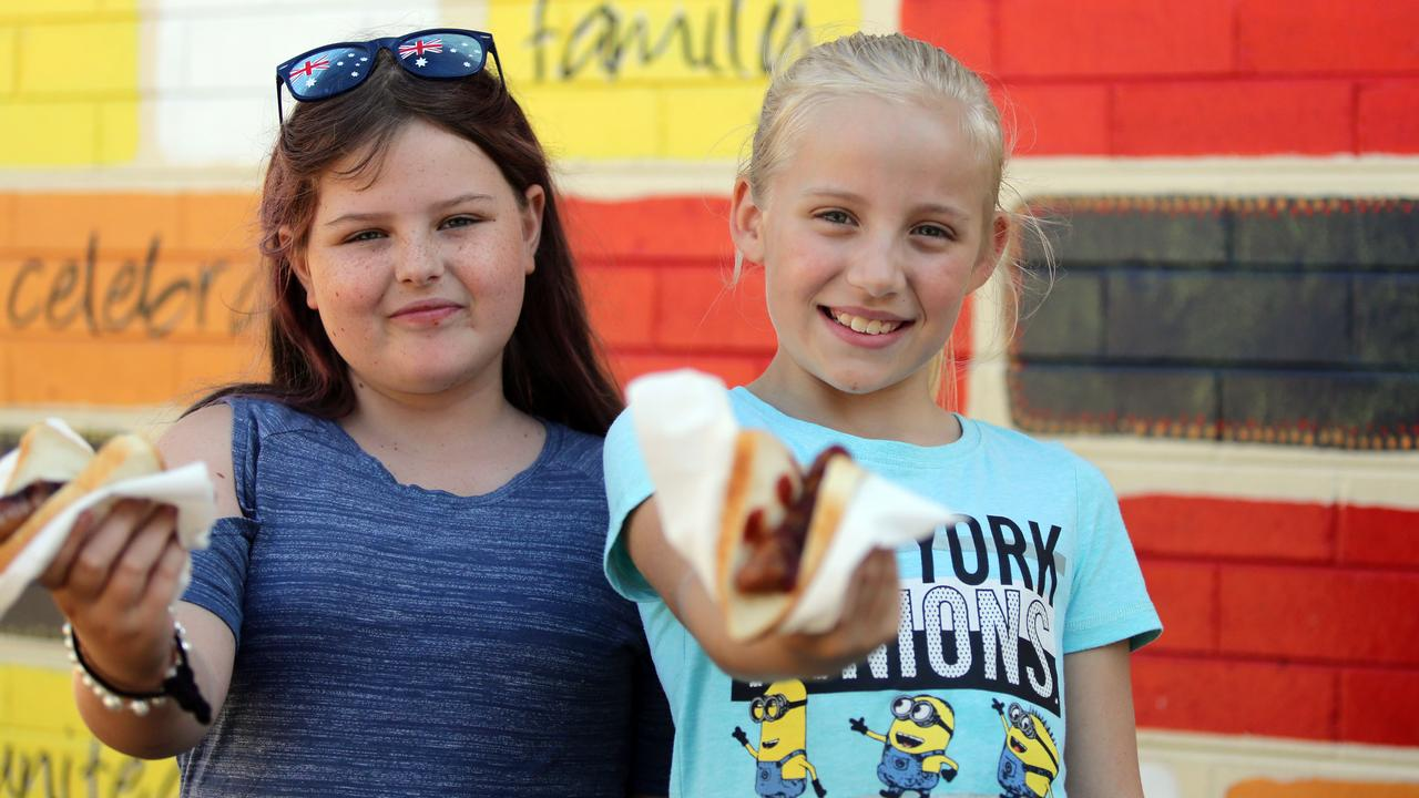 Kate and Emma at a sausage sizzle at a polling place at Prestons Public School on the day of the recent NSW state election. Picture: AAP