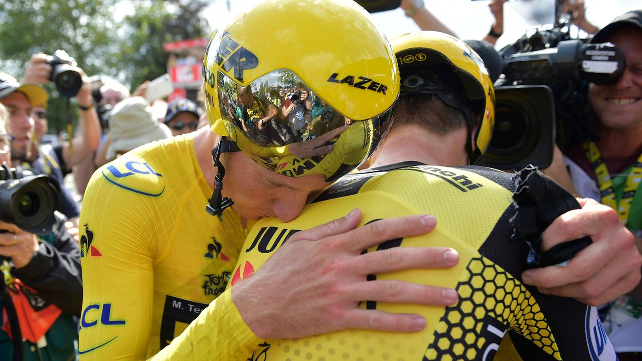 Dutch rider Mike Teunissen (L) celebrates after winning the second stage in a row with his team Jumbo. (Photo by YORICK JANSENS / BELGA / AFP)