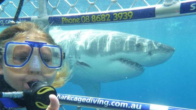 Even kids are taking part of the selfie craze with sharks showing a thumbs up. Picture: CALYPSO STAR CHARTERS / MEDIADRUMWORLD.COM