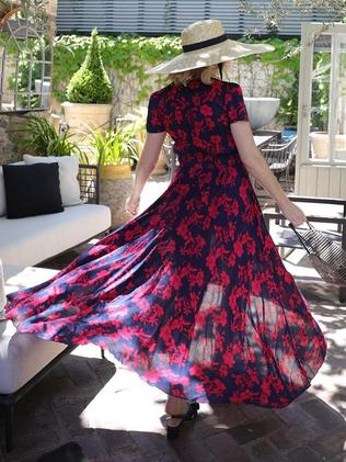 Stylist Kash O'Hara opted to purchase the dress in a striking shade of navy with a stunning red floral pattern. Picture: Instagram / thestyledr