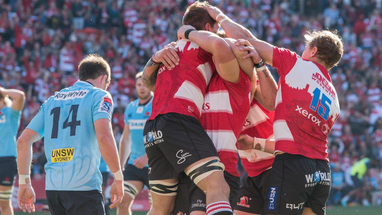 Lions players celebrate a try to Kwagga Smith. Picture: AFP