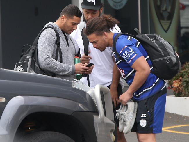 Asipeli Fine (middle) and Marcelo Montoya (left) arrive at Belmore headquarters after Mad Monday.