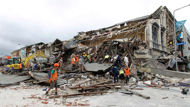 CHRISTCHURCH, NEW ZEALAND - FEBRUARY 23: Rescue workers search for survivors on February 23, 2011 in Christchurch, New Zealand. The 6.3 magnitude earthquake - an aftershock of the 7.1 magnitude quake on September 4 - struck 20km southeast of Christchurch at around 1pm local time, with initial reports suggesting damage and fatalities far exceeding the initial quake. (Photo by Martin Hunter/Getty Images)