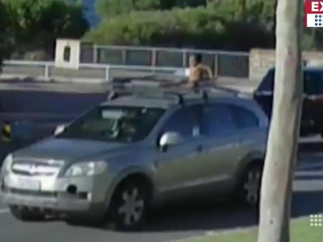 The boy on top of the car being driven by his mother. Picture: Nine News