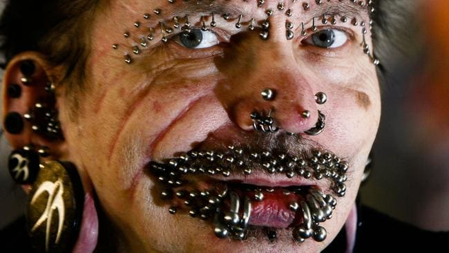 German Rolf Buchholz has 453 metal piercings all over his body, with 278 being on his penis alone. Picture: AP Photo/Markus Schreiber